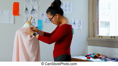 Fashion designer working on the dress makers model 4k