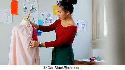 Fashion designer working on the dress makers model 4k -...