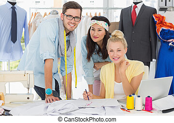Fashion designers at work - Group of fashion designers at ...
