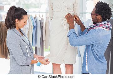 Fashion designers picking needles