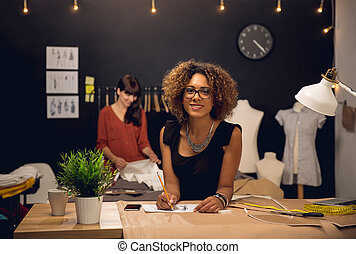 Fashion designers - Two young entrepreneur women, and ...