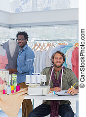 Fashion designers working in a creative office