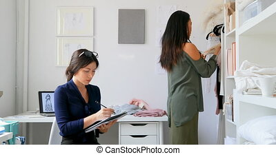 Fashion designers working in the design studio 4k