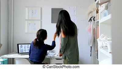 Fashion designers working together on a fabric 4k - Fashion...