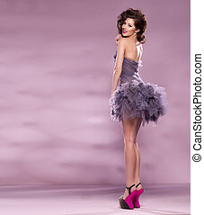 Fashion Dressed Sexy Girl. Woman in Purple Dress and High pink Heels
