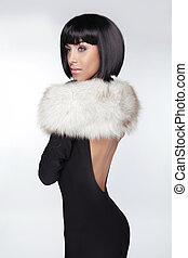 Fashion Elegant Woman in black dress. Brunette Lady with Black Short Hair. Vogue Style. Model posing at studio.