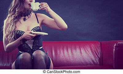 Sensual lady is drinking tea.