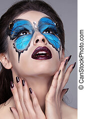 Fashion face art portrait. Manicured nails. Makeup. Beautiful model woman posing isolated on gray background.