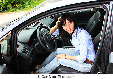 Fashion girl in a car