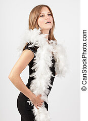 Fashion girl in feather boa - Young attractive blond woman...