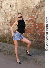 Fashion girl in near the wall