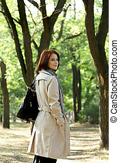Fashion girl in the park.