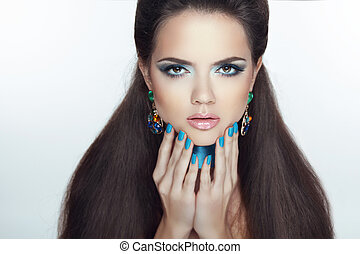 Fashion girl model. Manicured nails. Beautiful woman with Professional make-up and healthy hair styling.