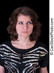 Fashion girl posing on dark background - portrait