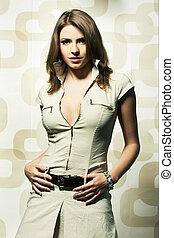 Fashion girl posing on light background