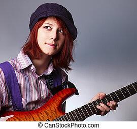 Fashion girl with guitar