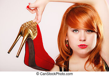 Fashion girl with red high heel stiletto shoes.