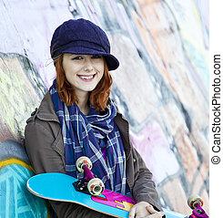 Fashion girl with skateboard.