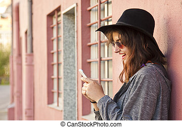 fashion girl with the phone on street