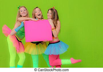Fashion girls in neon clothing holding blank pink billboard