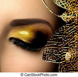 Fashion Glamour Makeup. Holiday Gold Glittering Eyeshadows
