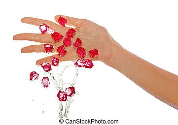 fashion jewelry in the hands of the girl splashing in the...