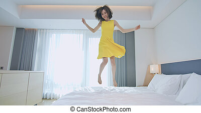 Fashion lady jump on bed