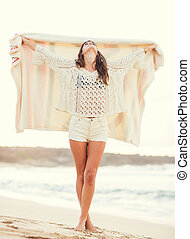 Fashion lifestyle, beautiful young woman on the beach at...