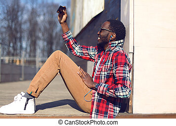 Fashion lifestyle photo happy young african man makes...