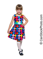 Fashion little girl stands against the white
