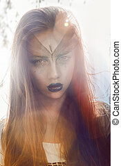Fashion long haired girl with art make up