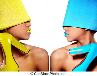 High fashion look. glamour fashion beautiful black American woman with blue and yellow bright lips with blue and yellow material with blue and yellow open-toe in hand