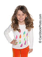 Fashion lovely little girl against the white