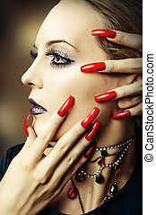 fashion make up and long red nails - Woman face with fashion...