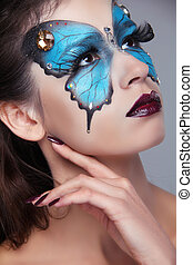 Fashion Make up. Butterfly makeup on face beautiful woman. Art Portrait.