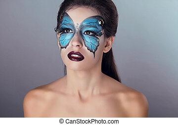 Fashion Makeup. Butterfly face art woman Portrait.
