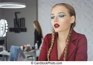 Fashion makeup. Woman with colorful makeup and body art