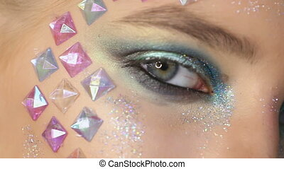 Fashion makeup. Woman with colorful makeup and body art.