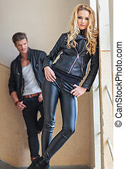 fashion man and woman in leather clothes posing