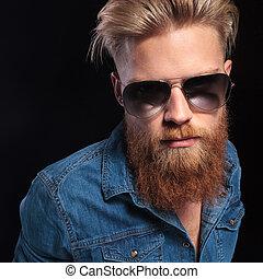 fashion man in blue shirt wearing sunglasses posing