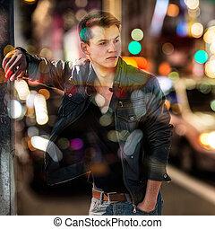 Fashion man in car traffic