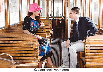 man in suit in the wagon train with woman look at each other fac