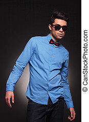 fashion man in sunglasses posing