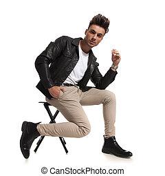 fashion man sitting on a chair