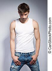 fashion man - young beautiful man in white t-shirt posing