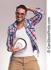 Fashion man taking off his hat