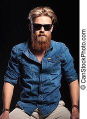 fashion man wearing blue shirt, posing for the camera.