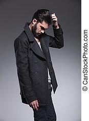 fashion man with long beard scratching his head - side...