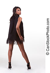 Fashion model Afro American woman in black dress