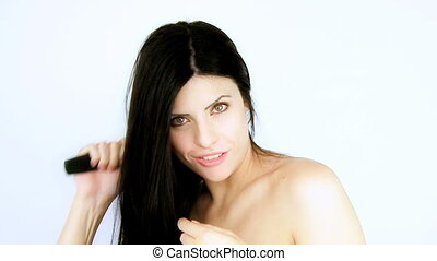 Fashion model brushes silky hair - Fashion female model...